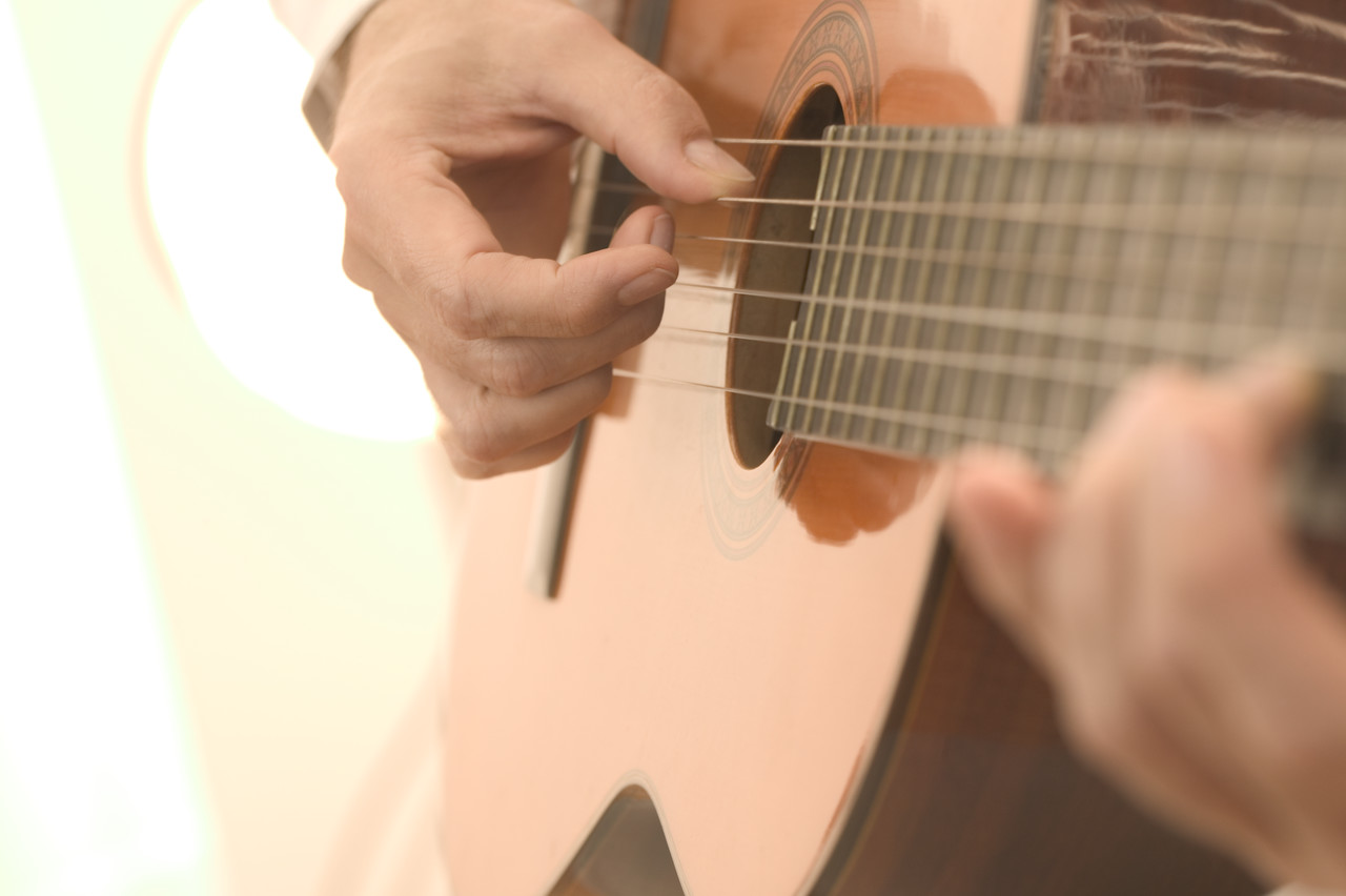 Strumming an Acoustic Guitar
